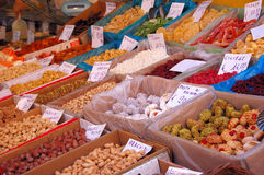 Street comerce. Market offers: dry fruits,nuts,sweats Stock Photography