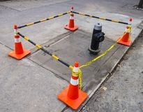 Street cones with connecting striped orange white plastic bars stock photography
