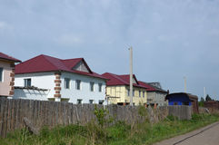 Street construction of two-storey houses. Housing. Different degrees of completion stock image