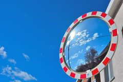 Street convex mirror. Reflection from the air in a street convex mirror Royalty Free Stock Photo