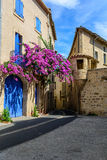 A street corner in the historical center of Pezenas, Languedoc, France. A street corner with flowering bougainvillea in the historical center of Pezenas Royalty Free Stock Photos