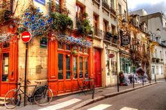 A Street Corner in Paris. Paris, France -  This little corner caught my eye.  It looked like a nice little quaint spot.  This is the Eurl Bistrot Au Bougat.  It Royalty Free Stock Photos