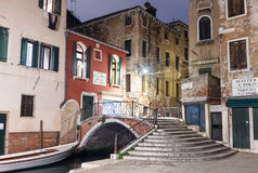 Street corner in Venice with a bridge in the night Stock Photography