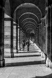 The street corridor. A couple is walking in the arch corridor in the city of Paris, France Royalty Free Stock Images