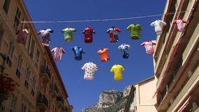 Street In Corsica with cycling vests hanging between buildings stock video