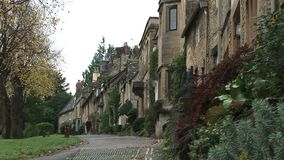 Traditional Cotswolds village. Street in the Cotswolds England with houses stock video footage