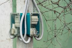Street counter of consumed electricity. The meter on the pole.  Royalty Free Stock Photos