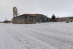 A street covered by snow in industrial area Royalty Free Stock Photo