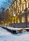 Street covered with snow at night old building Royalty Free Stock Images