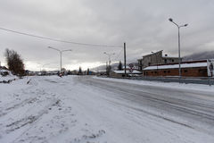 A street covered by snow in an old industrial area Stock Photos
