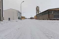 A street covered by snow in an old industrial area in south italy Stock Photos