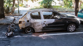Street crime set on fire car. Act of vandalism that ruined by a fire two vehicles Stock Image