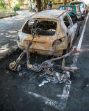 Street crime set on fire car. Act of vandalism that ruined by a fire two vehicles Stock Photos