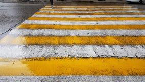 Street crossing feet shoes rainy Royalty Free Stock Photography