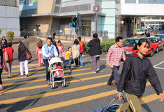 Street Crossing in Hong Kong. Busy Crossing Street in Hong Kong, China Stock Images