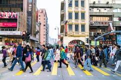 Street Crossing in Hong Kong. 16 February 2018 - Hong Kong. Pedestrians at Hong Kong. Crowds of people crossing the busy road Stock Photos