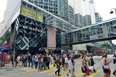 Street Crossing in Hong Kong. People crossing the Canton road in Tsim Sha Tsui District, Hong Kong Stock Photos
