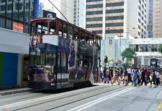 Street Crossing in Hong Kong. People crossing the Des Voeux road while the Tram is waiting in Central  District, Hong Kong Stock Photography