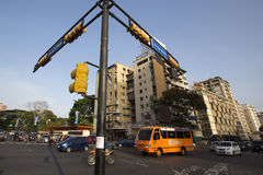 Street crossing with small traffic, bus, cars and motos, Caracas Stock Photos
