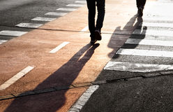 Street crossing with two pedestrians Stock Image
