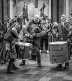 Street crowds in Glasgow. Scottish band Clanadonia entertaining the crowds on Buchanan street in Glasgow with their own unique style of music royalty free stock photo