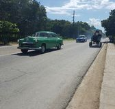 Street in Cuba. Oldtimer and cart on cuban street Stock Photography