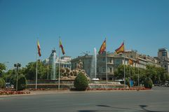 Street and Cybele fountain with Spanish flags in Madrid stock photos