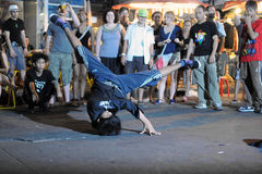 Street Dance. A b-boy breakdances at an informal street dance meet on Khao San Road on January 3, 2011 in Bangkok, Thailand. Breakdancing is a popular activity Royalty Free Stock Photos