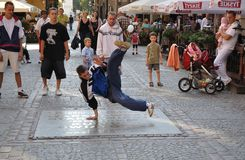 Street dancer. Performs breakdance moves in the Warsaw Old Town Royalty Free Stock Photos