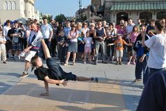 Street dancer. Performs breakdance moves in the Warsaw Old Town Royalty Free Stock Images