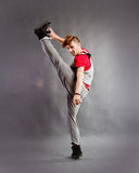 Street dancer. On studio background lifting up his leg stock photos