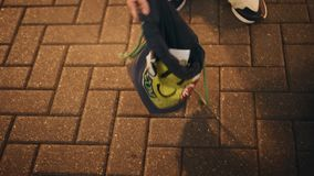 A street dancer collects money for performances. Close - up of hands with a bag. Money in the bag stock footage