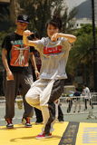 Street Dancer. A street dance is a dance style—regardless of country of origin—that evolved outside dance studios in any available open space such as streets Stock Photography