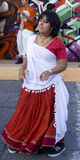 Street dancer hippie girl in red dress Stock Photo