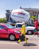 Street dancers collecting tips from motorists at intersection. Johannesburg, South Africa, 29th March - 2019: Street dancers that performing at traffic royalty free stock images