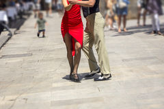 Street dancers performing tango in the street. Among the people Stock Images