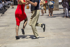 Street dancers performing tango in the street. Among the people Stock Photo