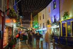 Street decorated with Christmas lights at night. Shop street decorated with Christmas lights. Galway, Ireland Royalty Free Stock Photography