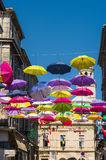 Street decorated with colored umbrellas. Arles, Provence. France Royalty Free Stock Image