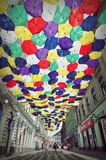 Street decorated with colored umbrellas. Stock Photos
