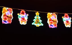 Street decorated with multicolor christmas lights Royalty Free Stock Images