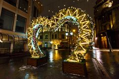 Street decoration with Christmas lights and Illuminated trees at winter night. City decorated by Christmas and New Year holidays. Royalty Free Stock Photos