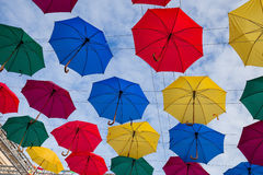 Street decoration, lots of colorful umbrellas in the air Stock Photos