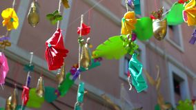 Street decoration made from recycled plastic bottles, bottle stopper and bags.