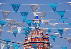Street decorations with church tower Royalty Free Stock Photos