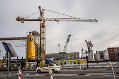 Street and derrick crane in Berlin Royalty Free Stock Images