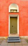 Street door. Brick wall, the evening sun Royalty Free Stock Photo