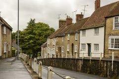Street downhill at Sherborne, Dorset Royalty Free Stock Photo