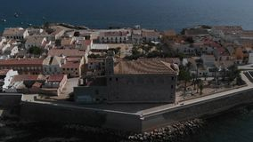 Aerial view of Island of Tabarca with old church and townscape. Spain stock video