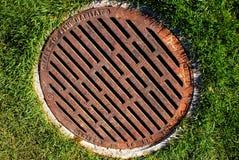 Street drain. A rusty metallic street drain stock images
